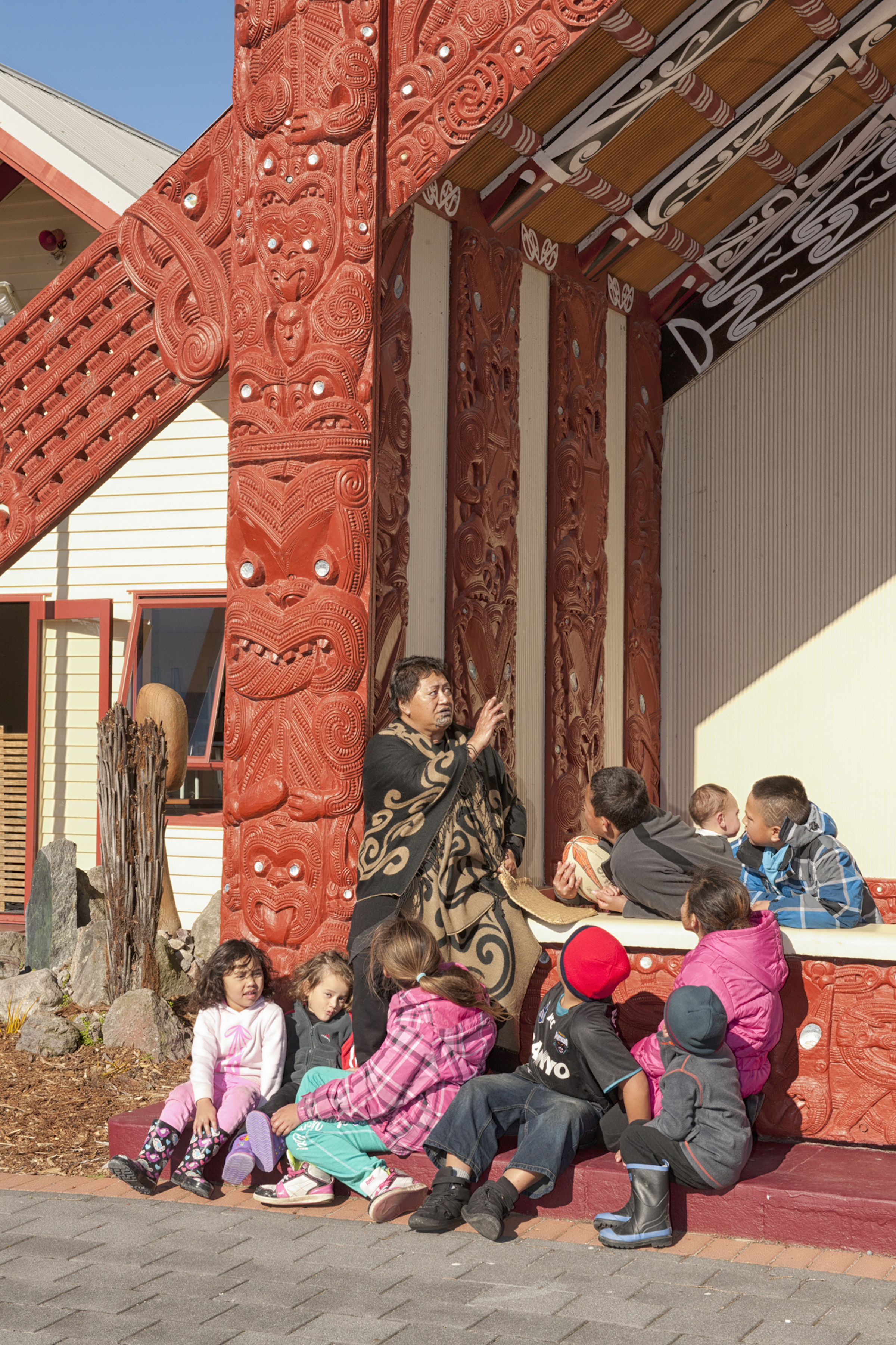 Educating children in front of the Meeting House