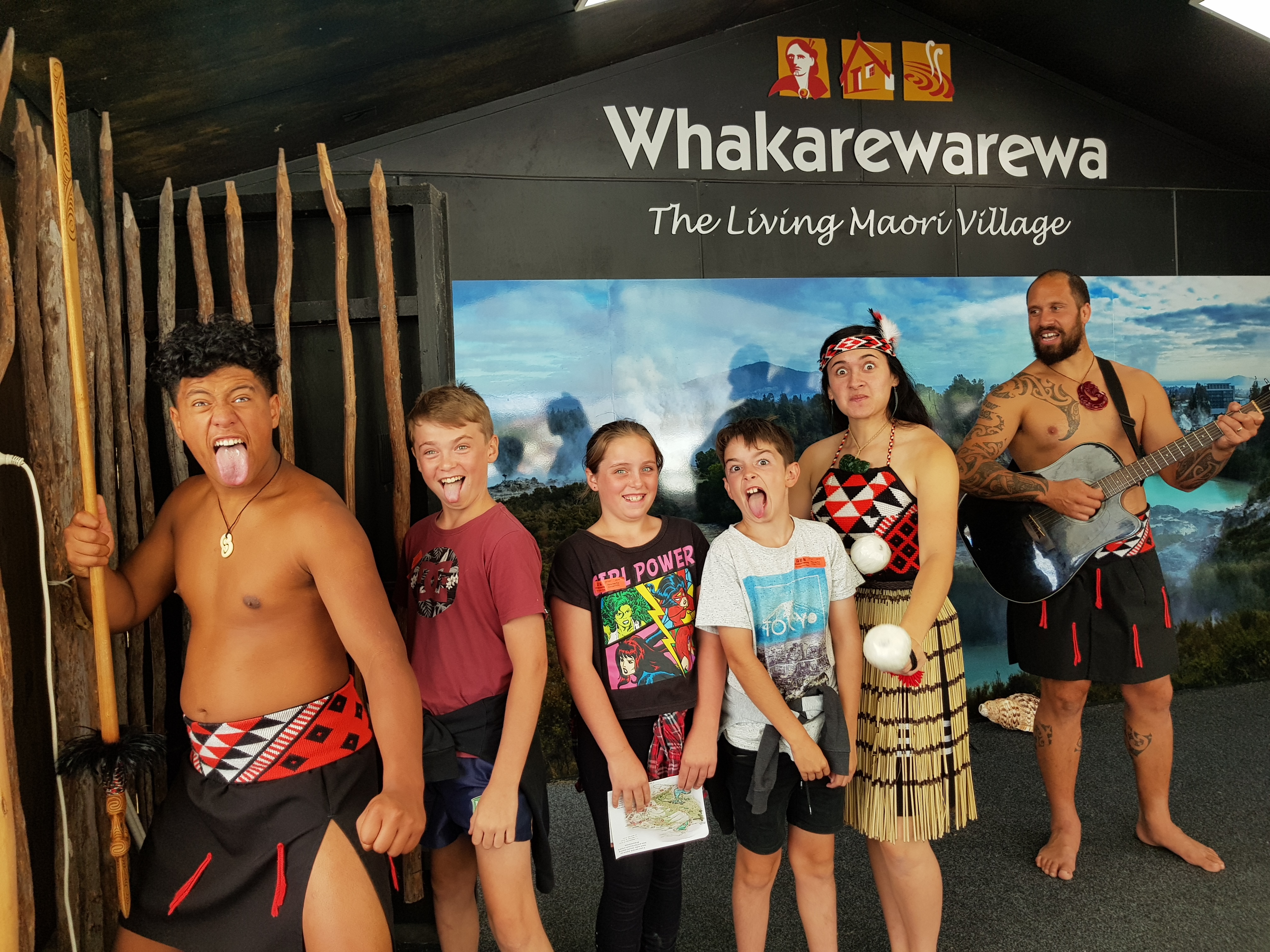 Families enjoying the Whakarewarewa Cultural Performance
